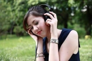 Girl with headphones enjoying music.