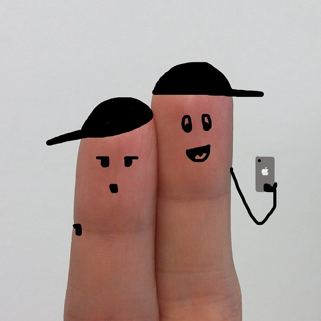 Two fingers taking a selfie together
