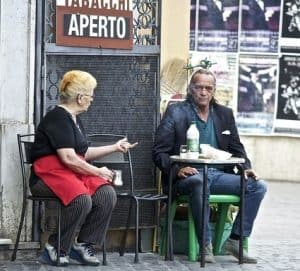 people talking at cafe in Rome