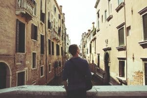 Teen overlooking a canal in Venice