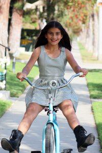 Teen girl riding a bike